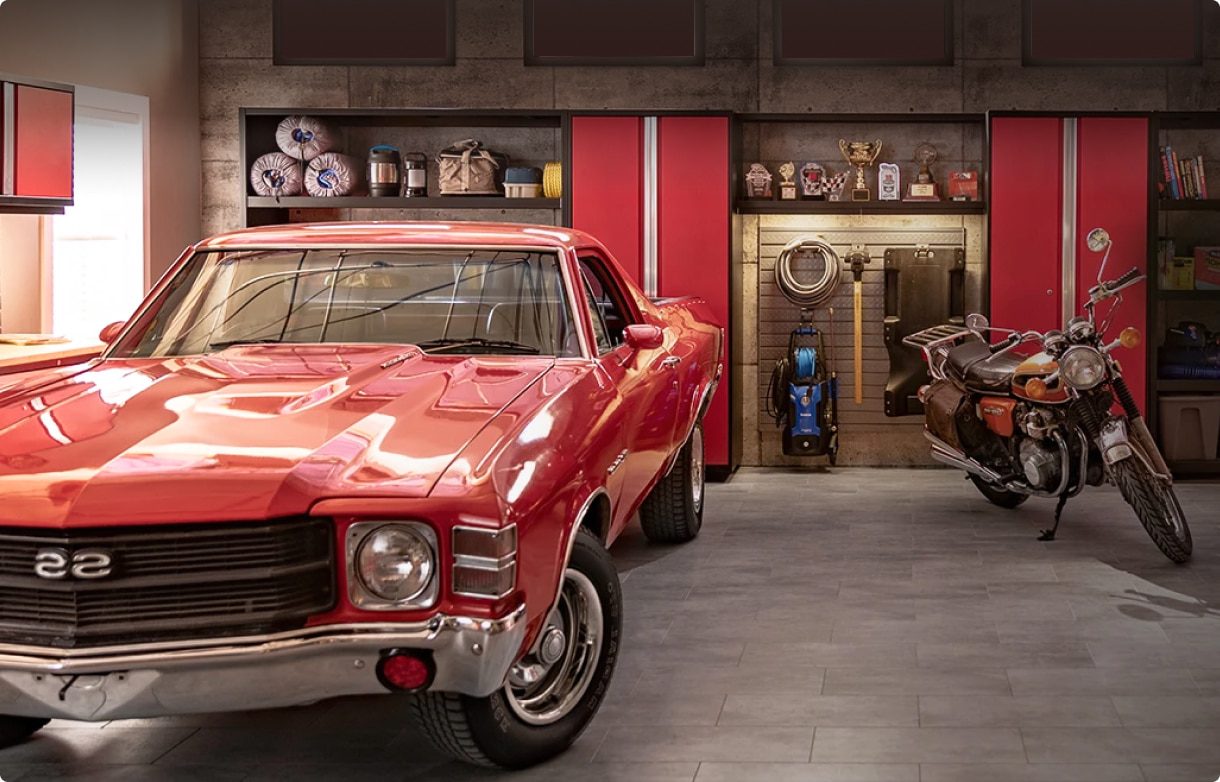 An impressive red garage cabinet saves space for an as much impressive red Chevrolet